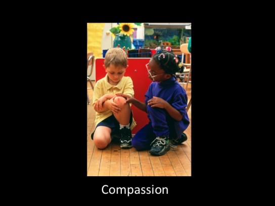 Pre-K girl (age 5) shows compassion to upset boy (age 5) in classroom